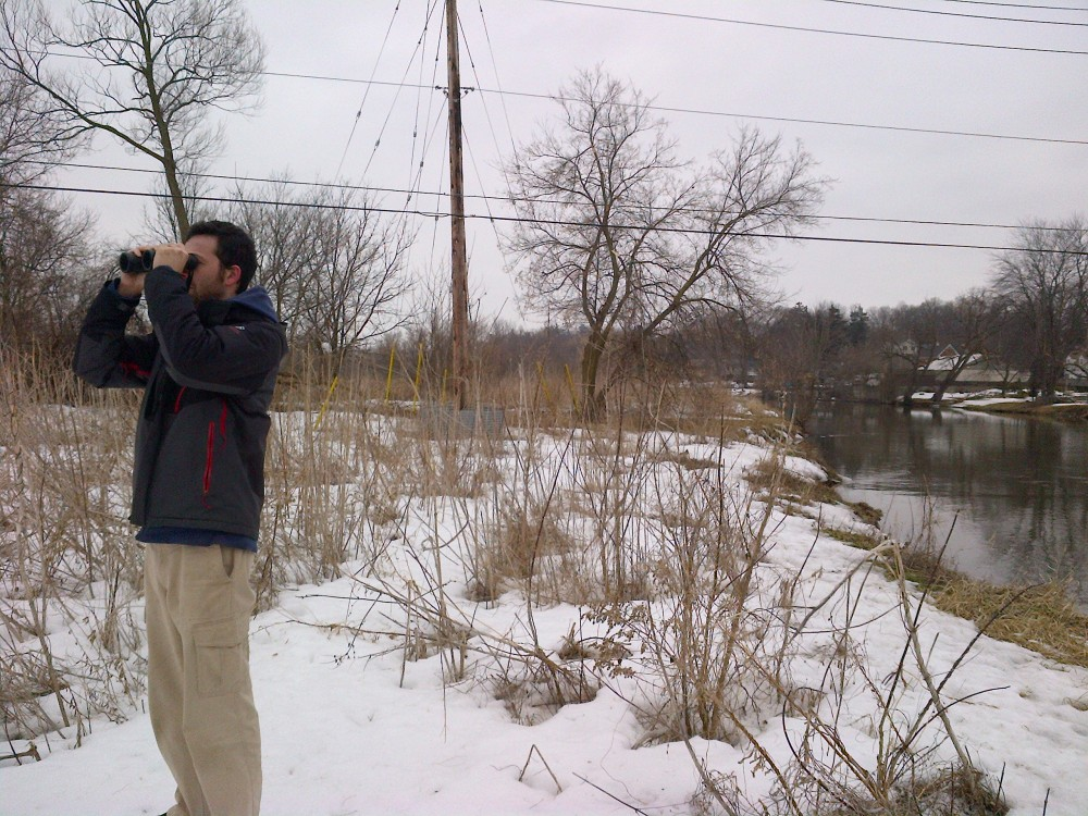 Will watches for birds through the binoculars.