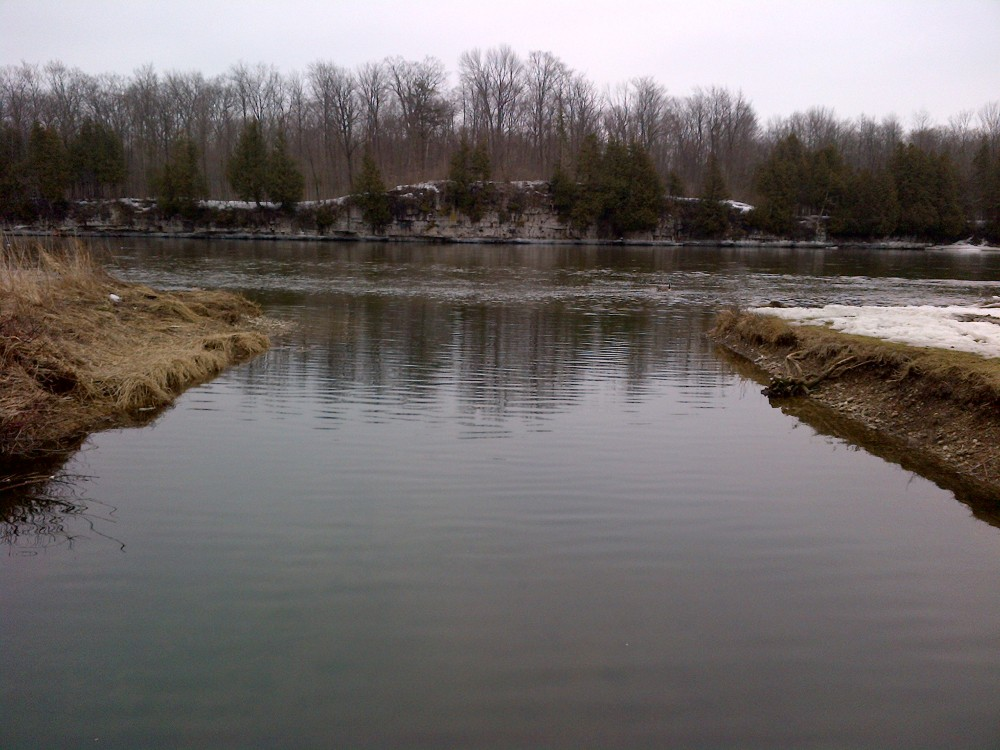 Looking out at limestone cliffs across the Grand River.