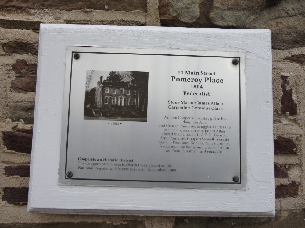 Historic plaque on the side of a building.