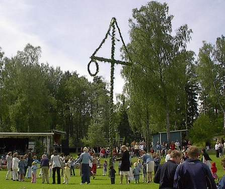 A maypole at a Midsummer celebration in Åmmeberg, Sweden.